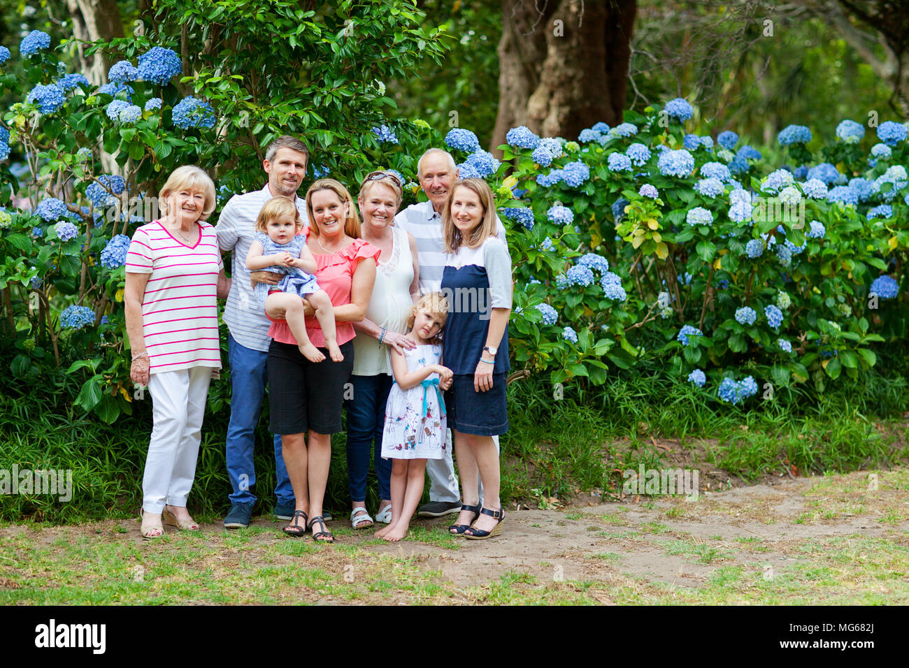 Family portrait of three generations in Arderne Gardens - Stock Image