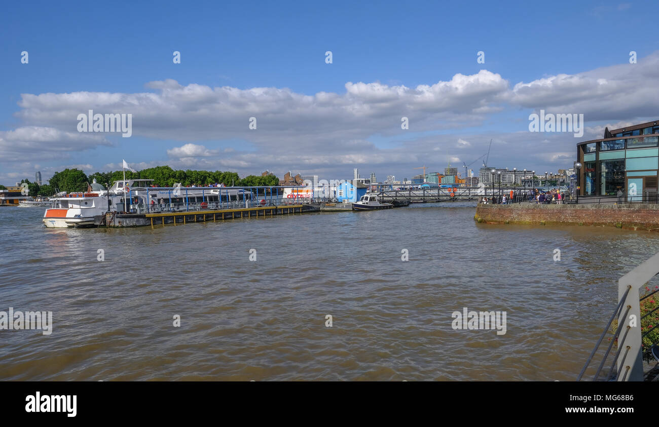 GREENWICH, LONDON, UK - AUGUST 10TH, 2017: Greenwich Pier with river boats and people. Stock Photo
