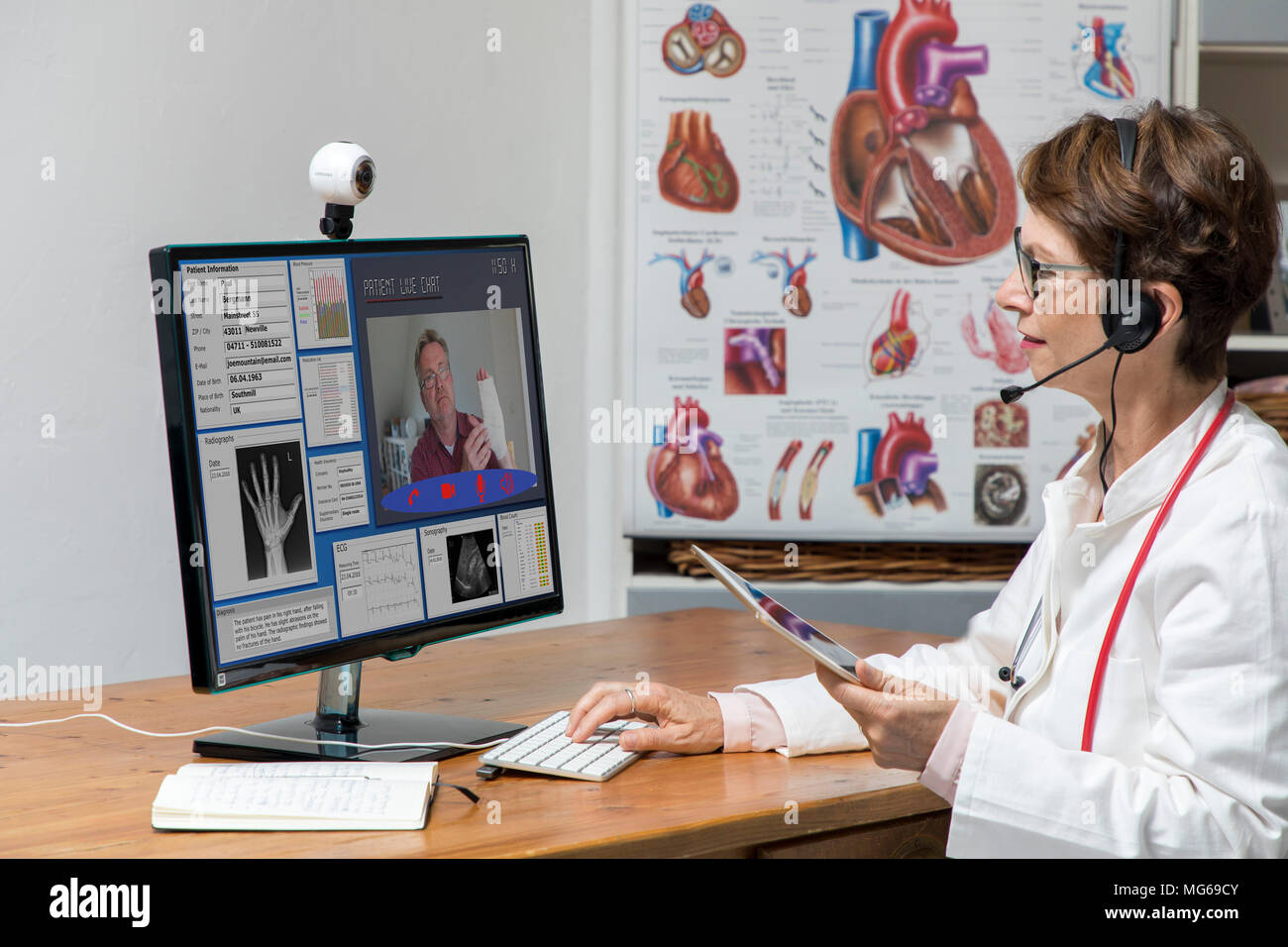 Symbolic photo on telemedicine, a doctor in a doctor's office, communicates with the patient via a webcam, patient data and findings on the monitor, - Stock Image