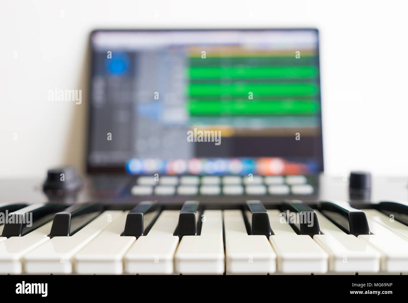 Working on Music Application with Music Keyboard - Stock Image