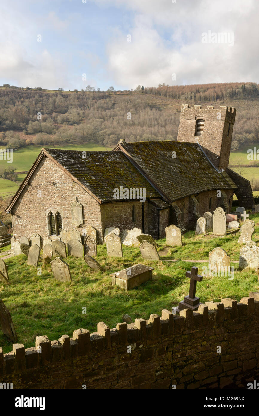 The church of St Martin in Cwmyoy, Wales, which uniquely features a leaning tower and walls that aren't square. - Stock Image