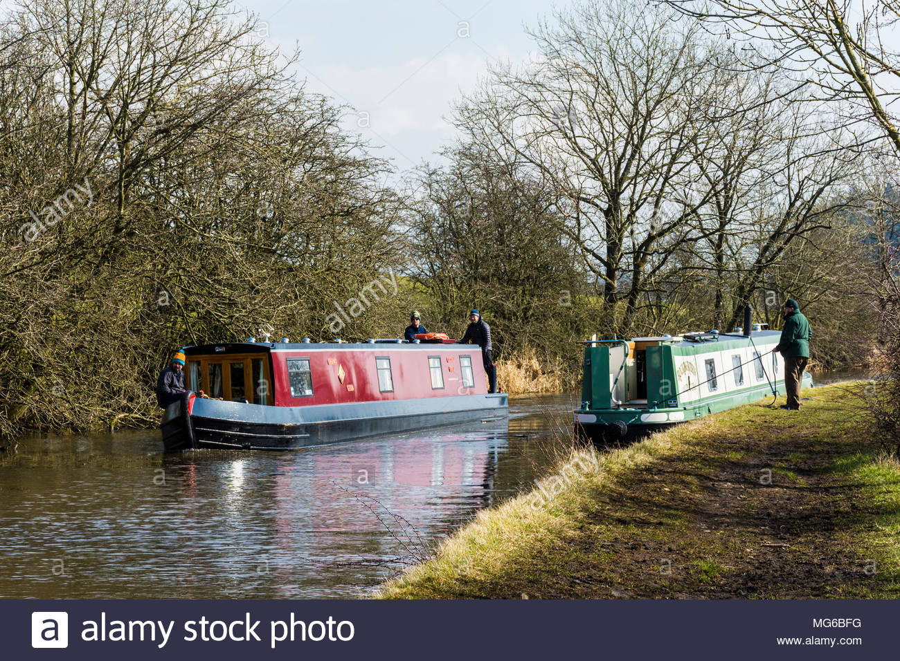 Narrowboats near to East Marton on the Leeds and Liverpool Canal on a sunny winters day - Stock Image