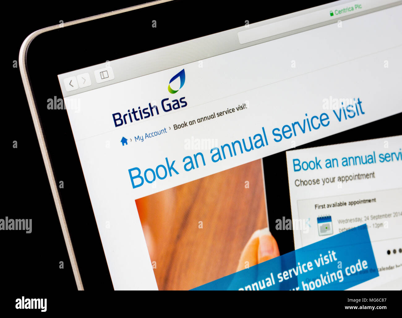 booking a service on the British Gas boiler service website - Stock Image