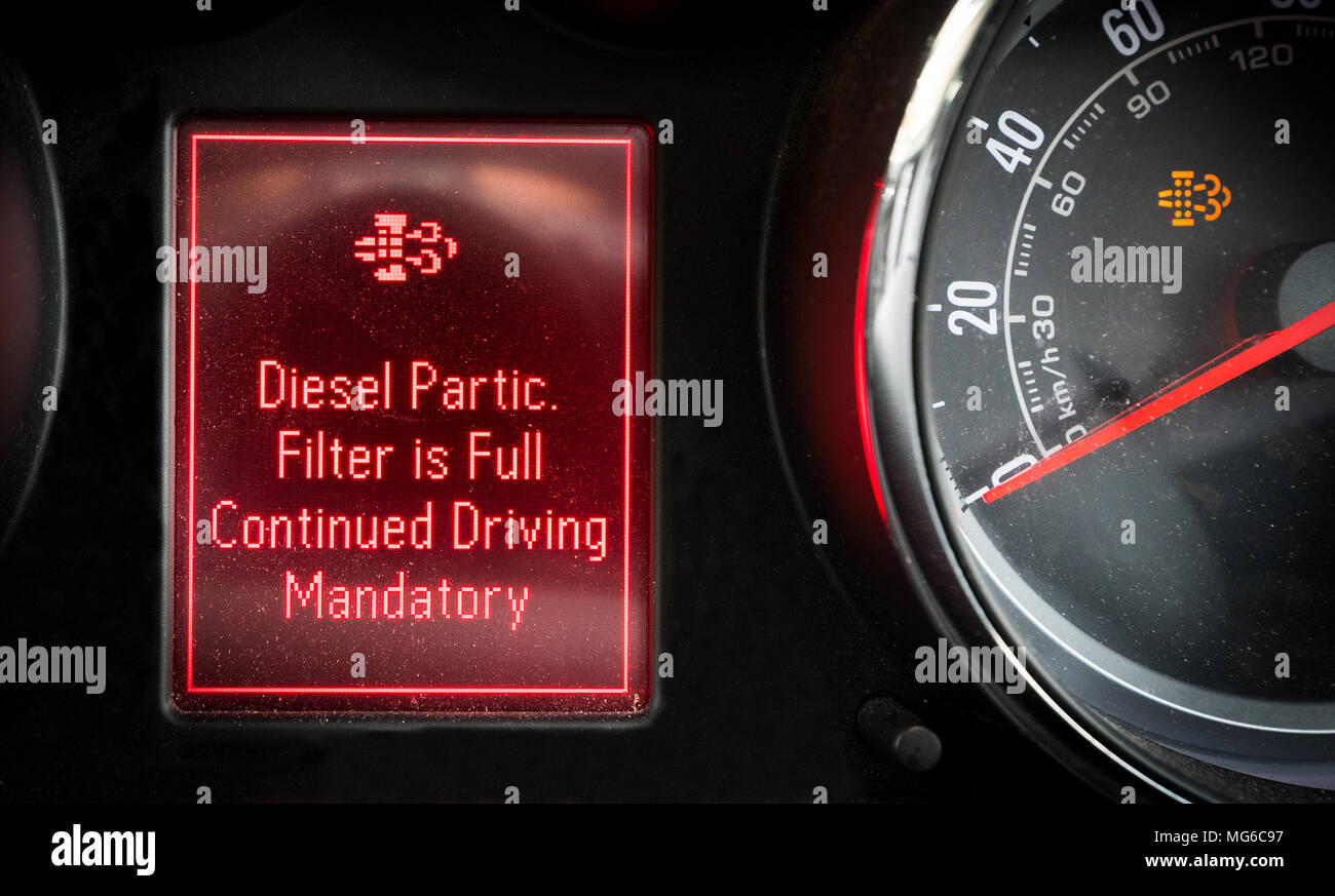 Diesel particulate filter warning light on a car dashboard - Stock Image