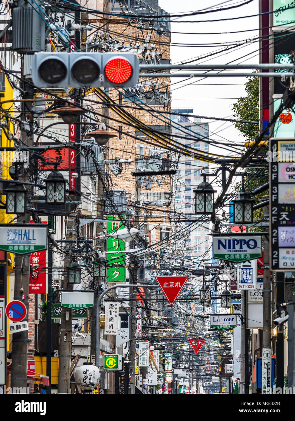 Osaka Japan Congested overhead cables in a street in Osaka Japan. Unlike most advanced nations the majority of Japan's power grid remains above ground - Stock Image