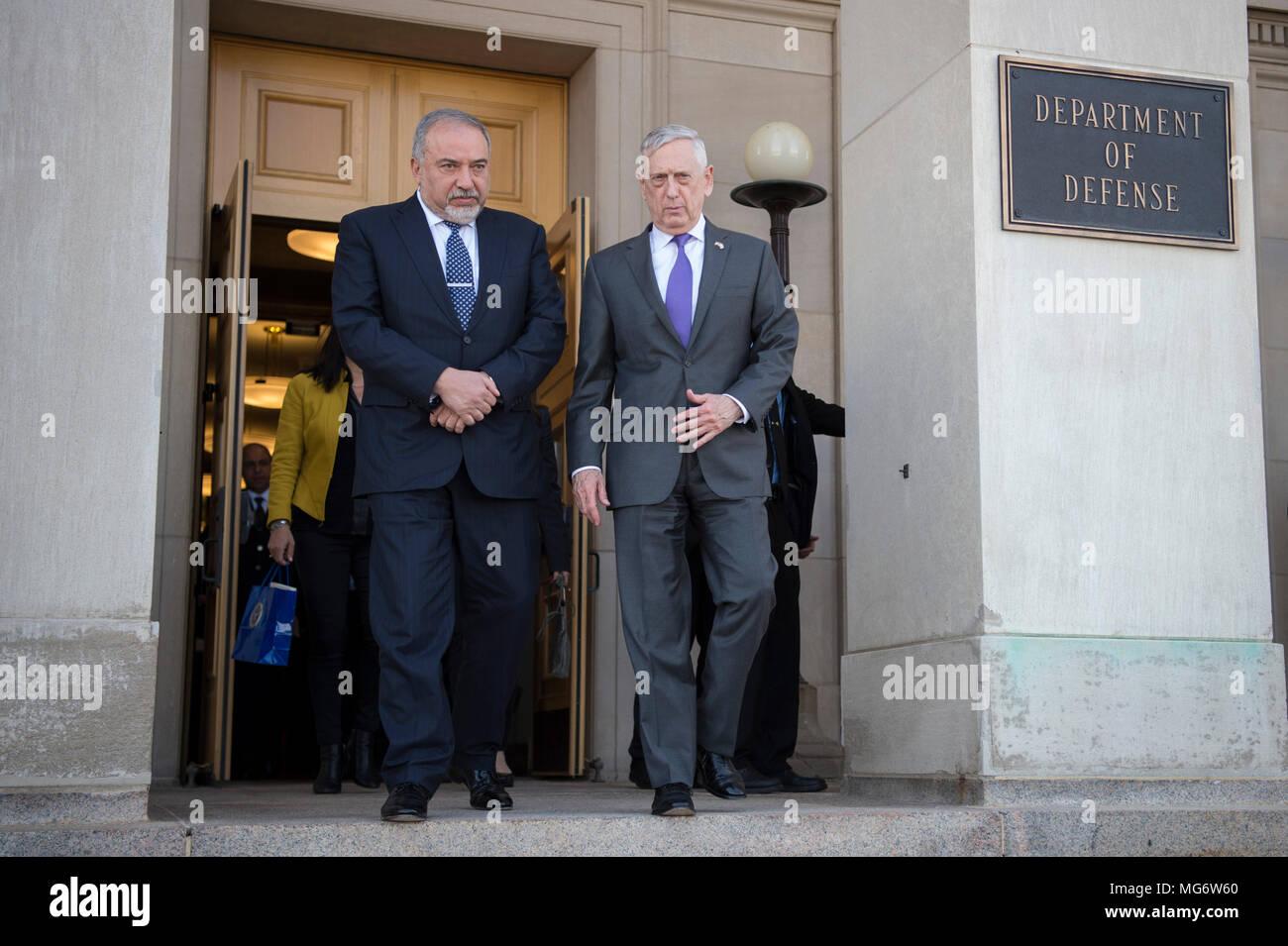 U.S. Secretary of Defense Jim Mattis escorts Israeli Defense Minister Avigdor Lieberman, left, to his vehicle following their bilateral meeting at the Pentagon April 26, 2018 in Arlington, Virginia. - Stock Image