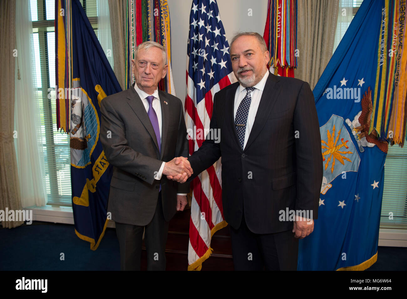 U.S. Secretary of Defense Jim Mattis welcomes Israeli Defense Minister Avigdor Lieberman, left, on arrival for a  bilateral meeting at the Pentagon April 26, 2018 in Arlington, Virginia. - Stock Image