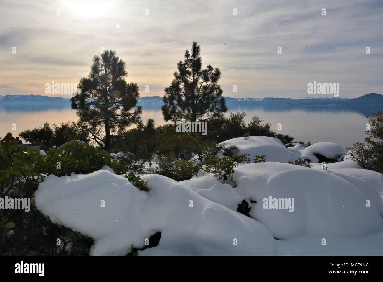 Wintery cloudy morning on the rocky shore of beautiful Lake Tahoe, Nevada Stock Photo