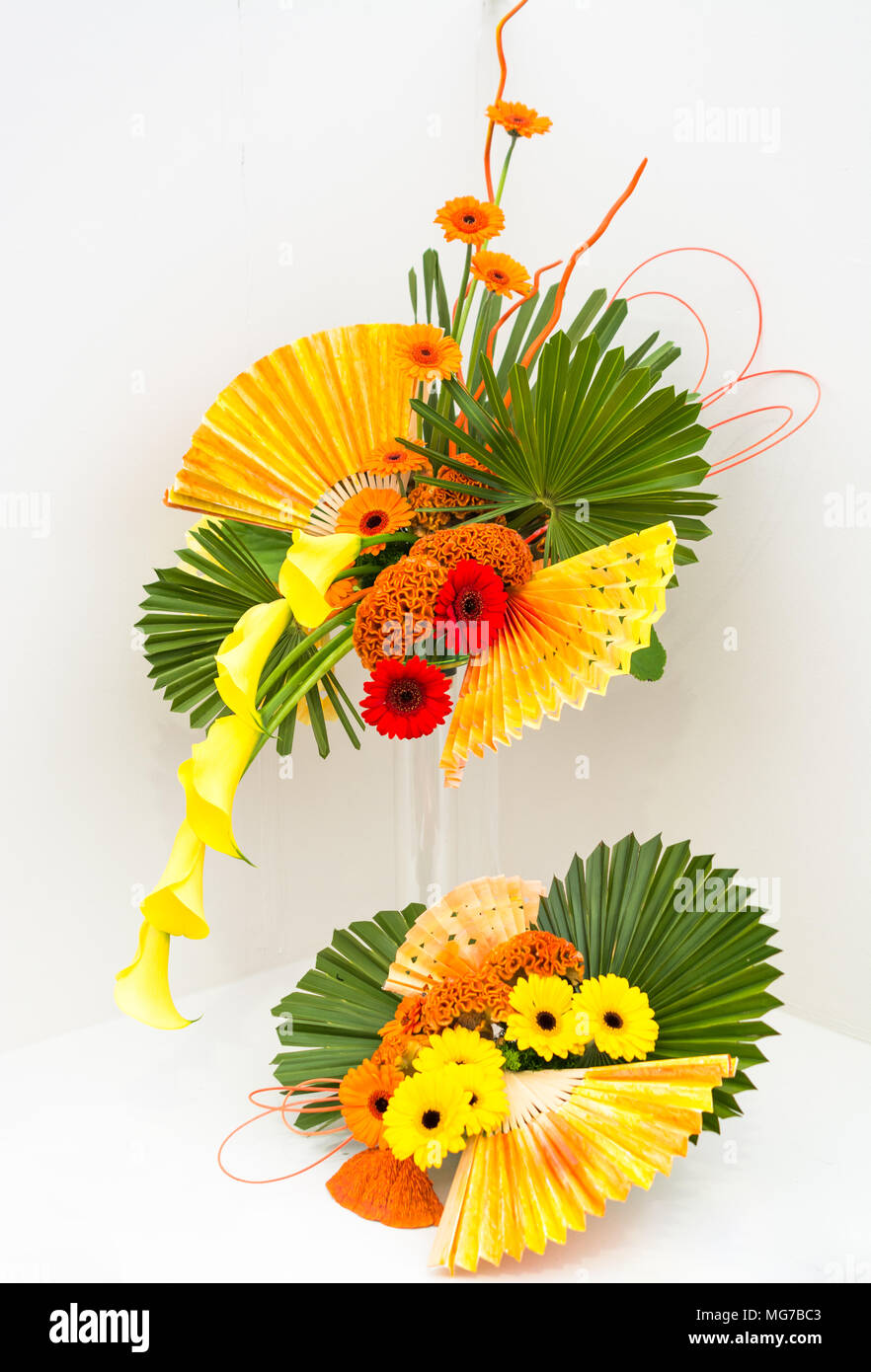 Orange And Yellow Floral Arrangement On A White Background Stock