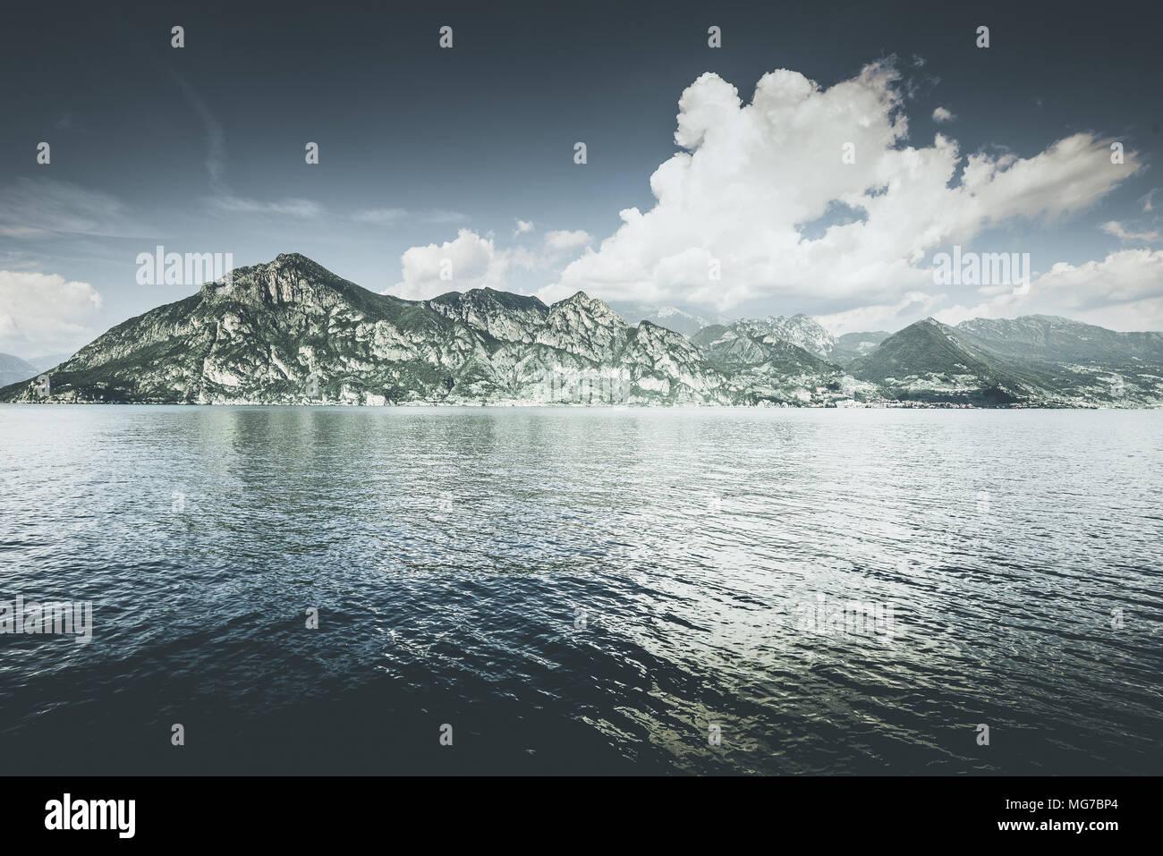 beautiful lake landscape - Iseo lake italy  spring mood - desaturated style image - Stock Image