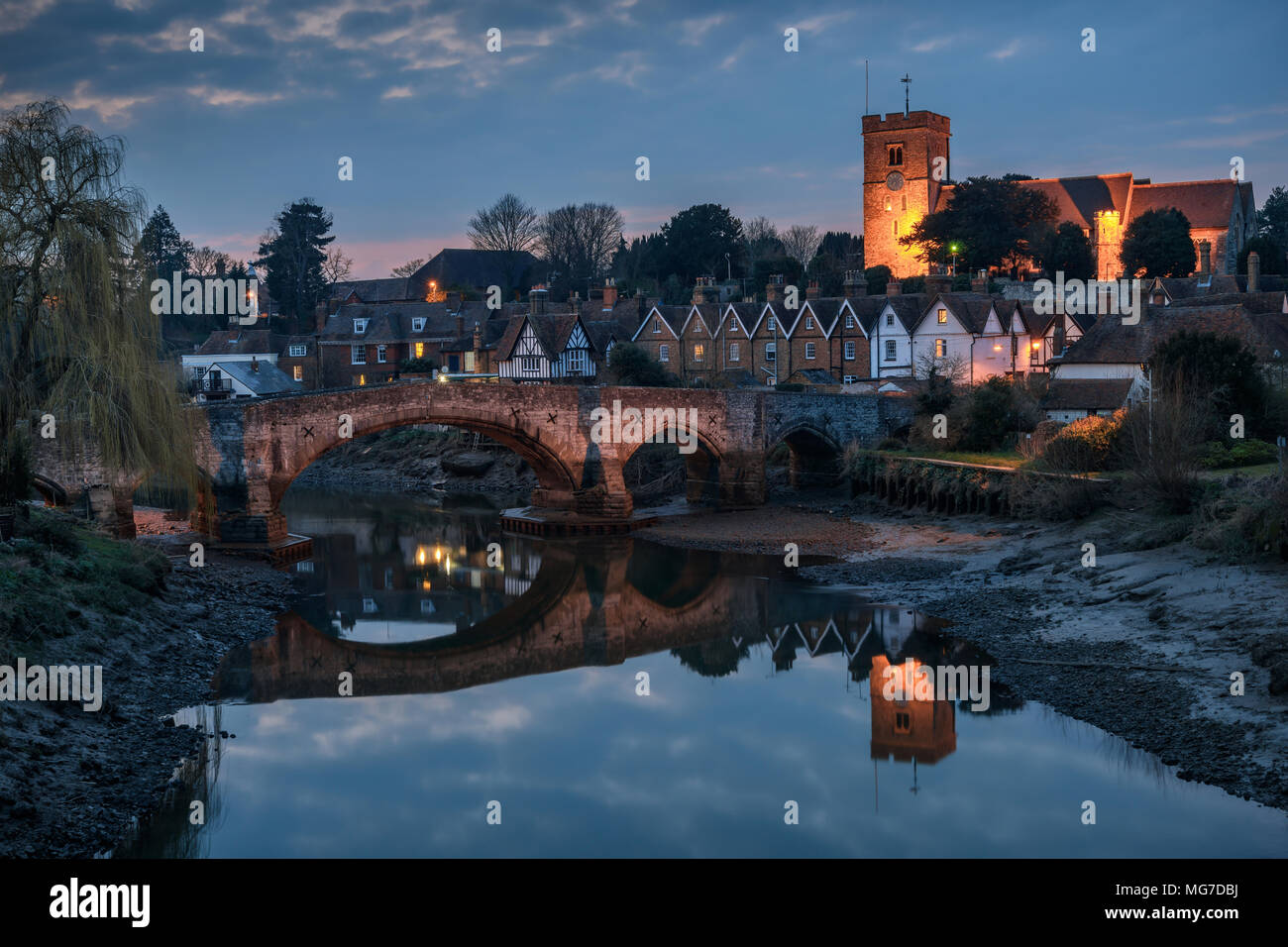 Night view to Aylesford village in Kent, England with medieval bridge and church. - Stock Image