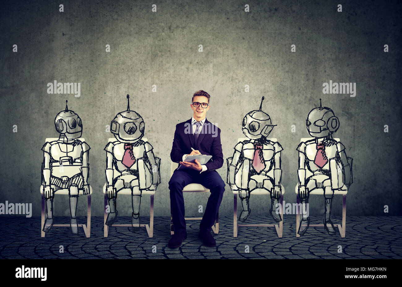Human vs Robots concept. Business job applicant competing with artificial intelligence - Stock Image