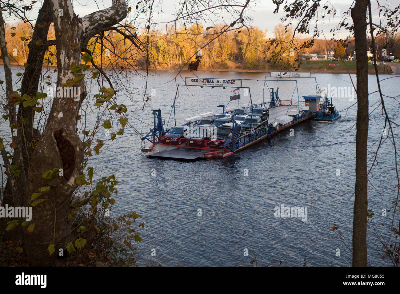 Historic White's ferry in Poolesville Maryland crossing the Potomac River. The ferry follows a wire cable to the other side of the river - Stock Image