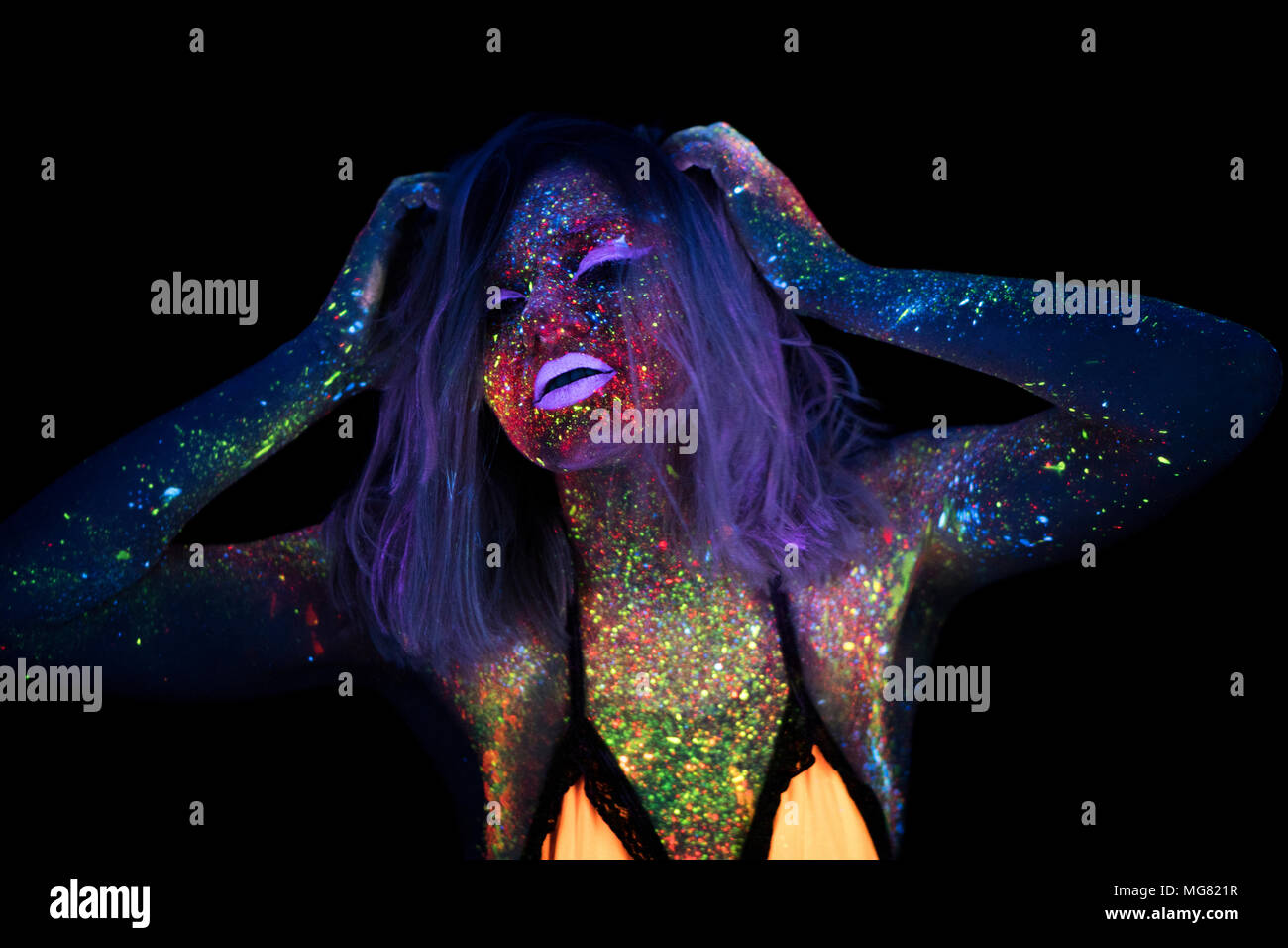 Portrait of Beautiful Fashion Woman in Neon UF Light. Model Girl with Fluorescent Creative Psychedelic MakeUp, Art Design of Female Disco Dancer Model in UV - Stock Image