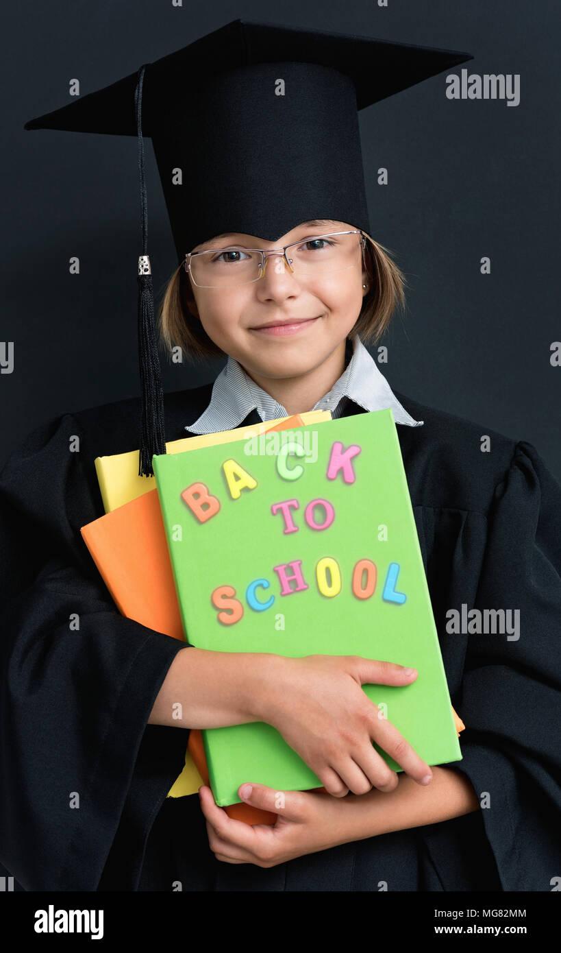 Graduation Sch | Portrait Of Graduate Little Girl Student In Black Graduation Gown