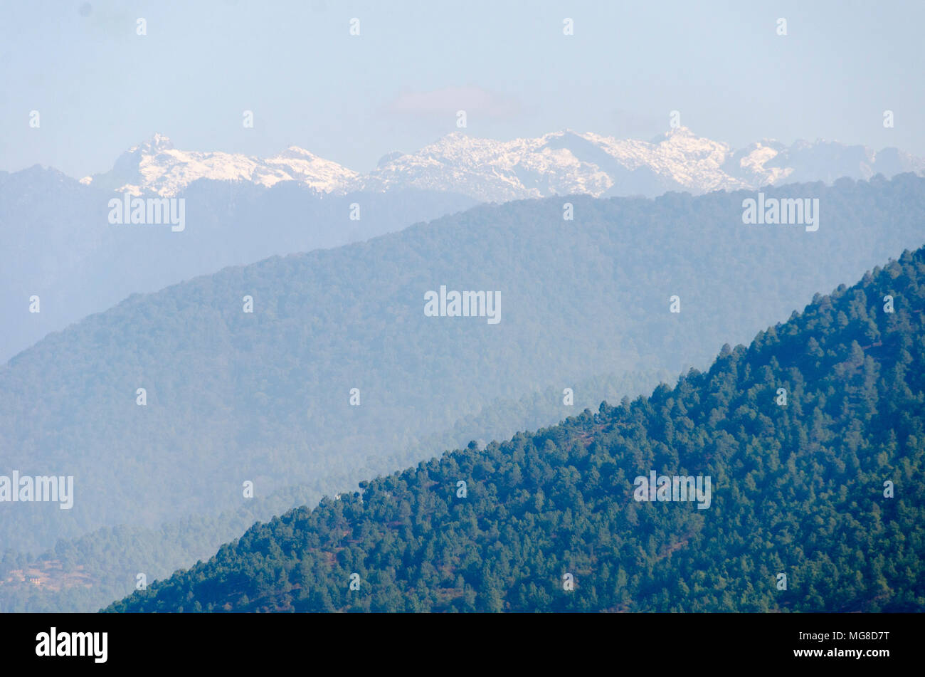 Misty ranges and snow capped mountains, Punakha, Bhutan - Stock Image