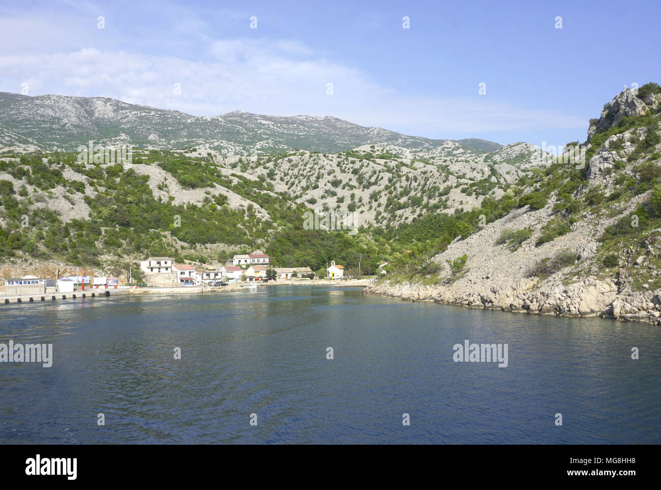 Prizna, Croatia, April 24, 2018. Small village Prizna, ferry port, sea view with Velebit mountain in the background, in the late spring Stock Photo