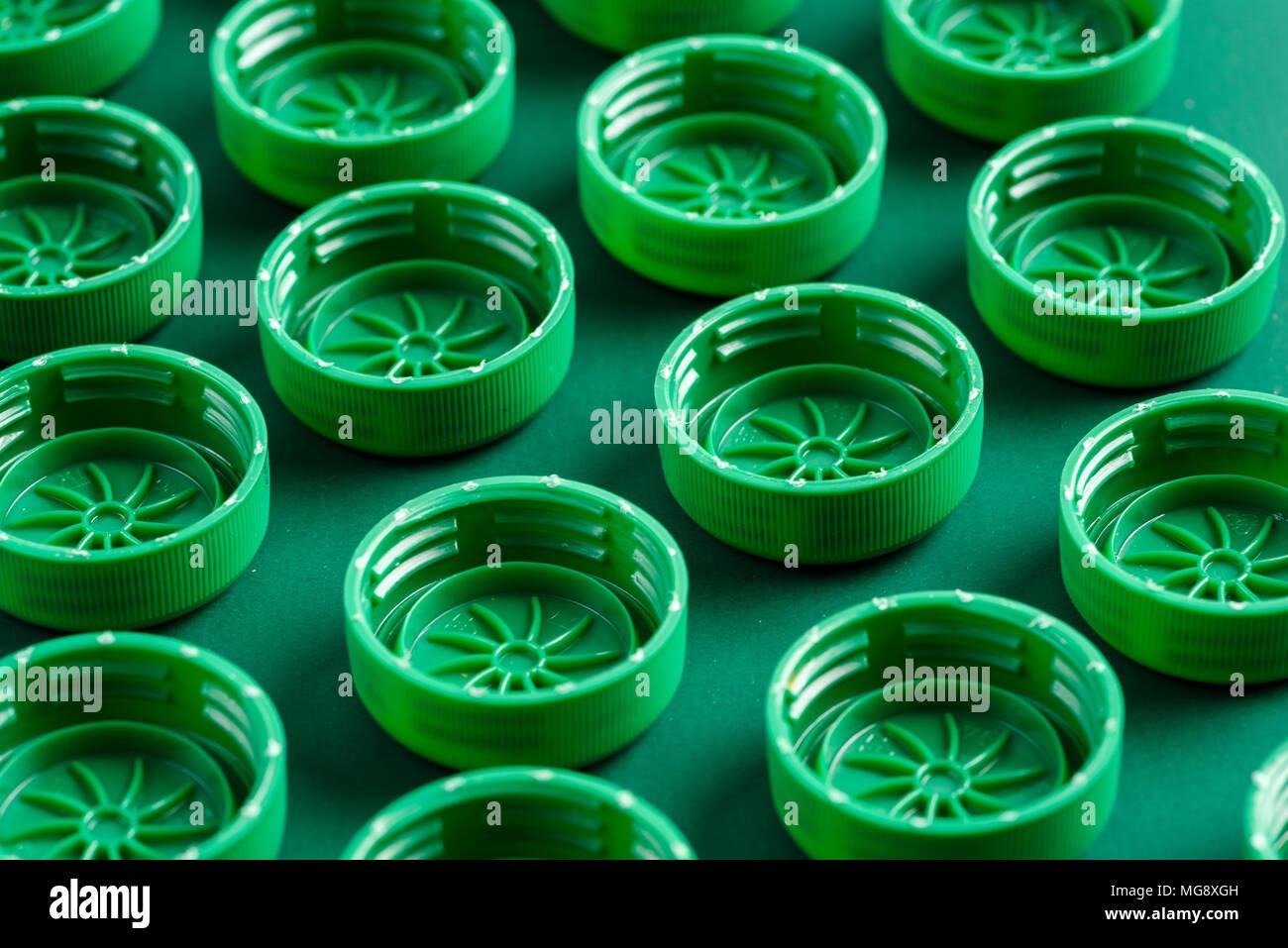 caps from plastic bottles folded - Stock Image