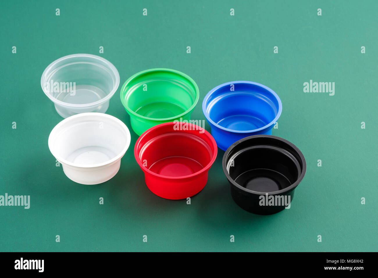 plastic containers for eating different colors - Stock Image