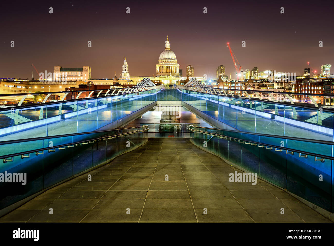 St Paul's Cathedral during night from the Millennium bridge over river Thames, London, United Kingdom. Stock Photo