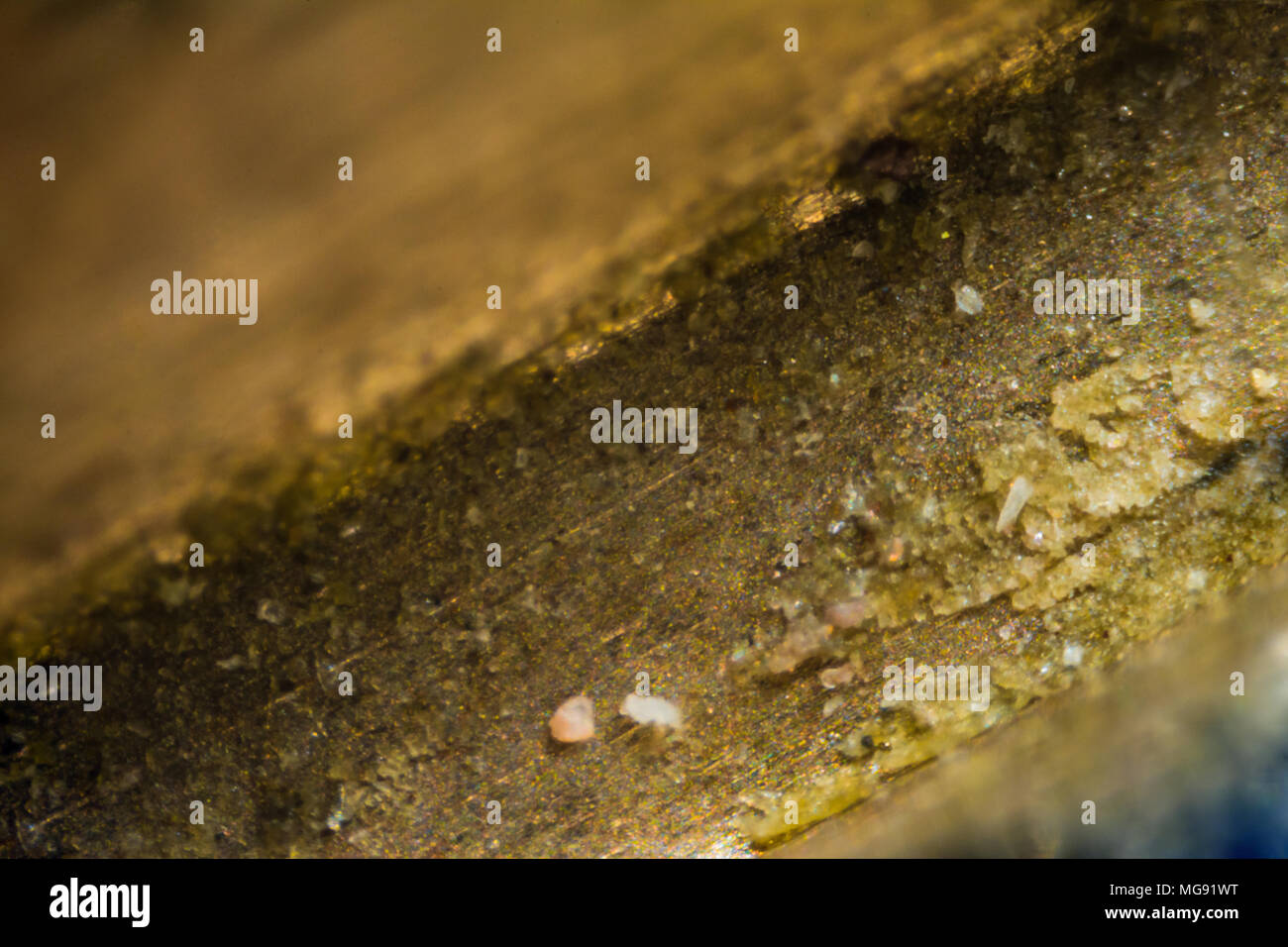 Metal key surface under the microscope. Closeup macro photography. - Stock Image