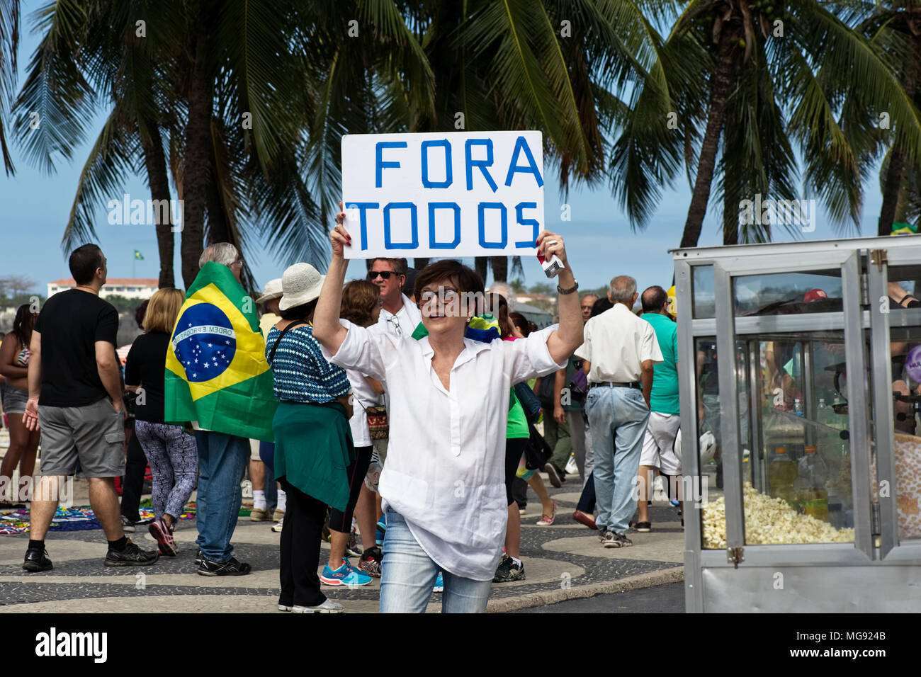 Rio de Janeiro, Brazil - July 31, 2016: A demonstrator displays a banner protesting against the corruption practiced by Brazilian politicians - Stock Image