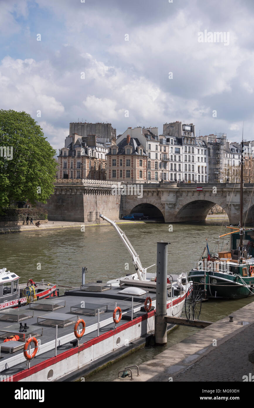 Sailing barges moored by the Pont Neuf, Paris, France - Stock Image