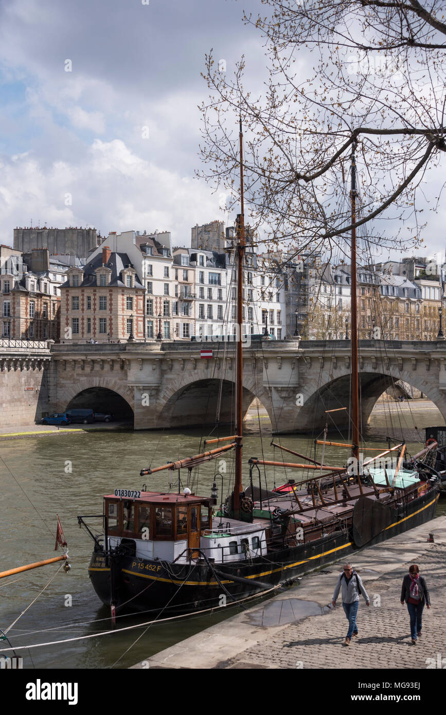 Sailing barges moored by the Pont Neuf, Paris, France Stock Photo