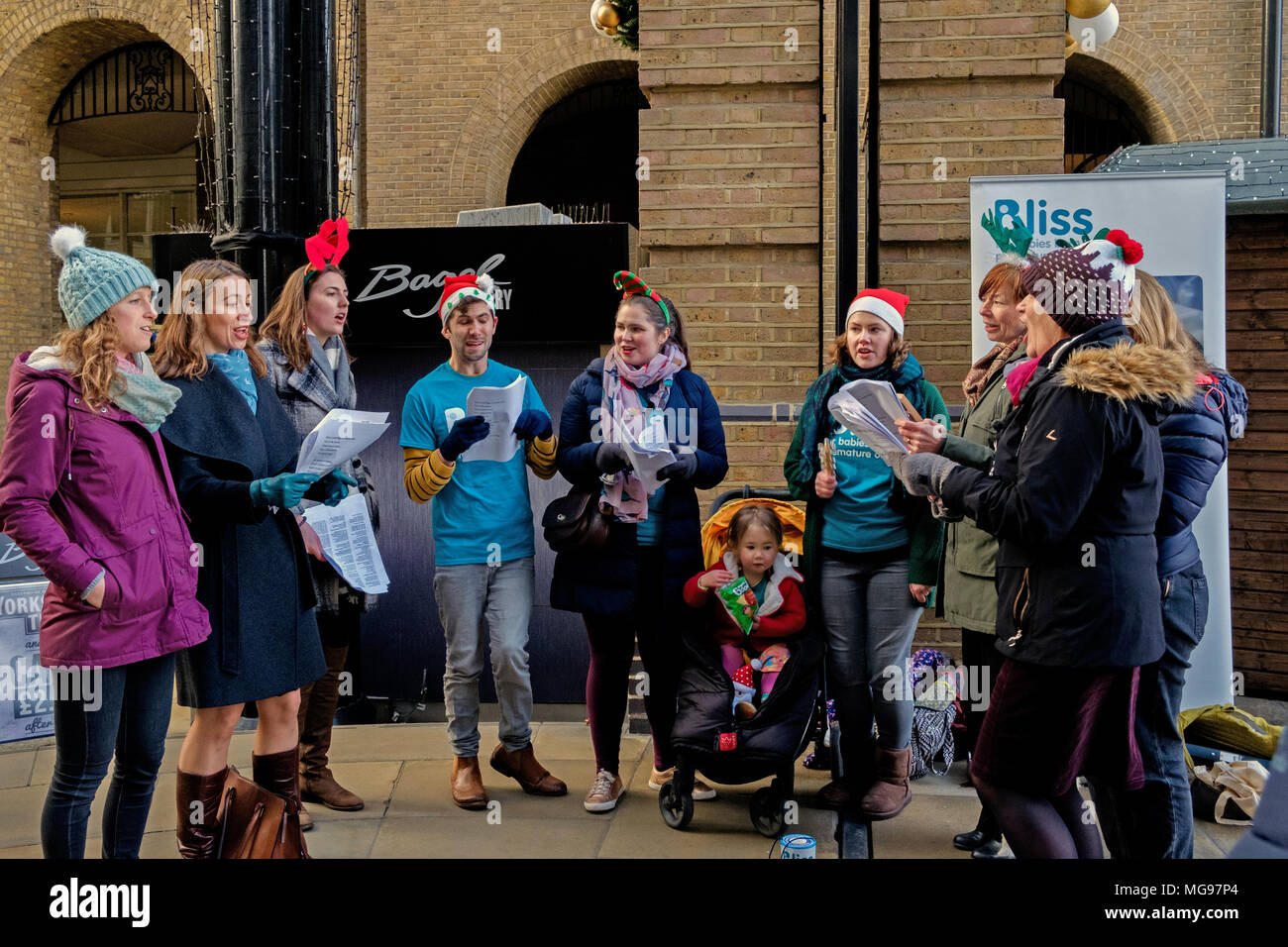 Bliss Charity Stock Photos Images Alamy Winter Hat Wh 97 Nine Volunteers Sing Christmas Carols At London Bridge Station To Raise Funds Awareness For