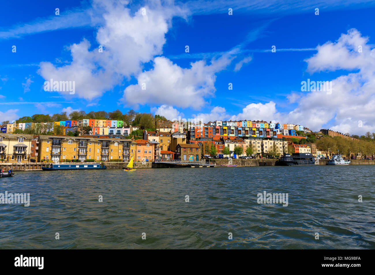 View across the river Avon of fluffy clouds over colourful houses of Bristol (UK). - Stock Image