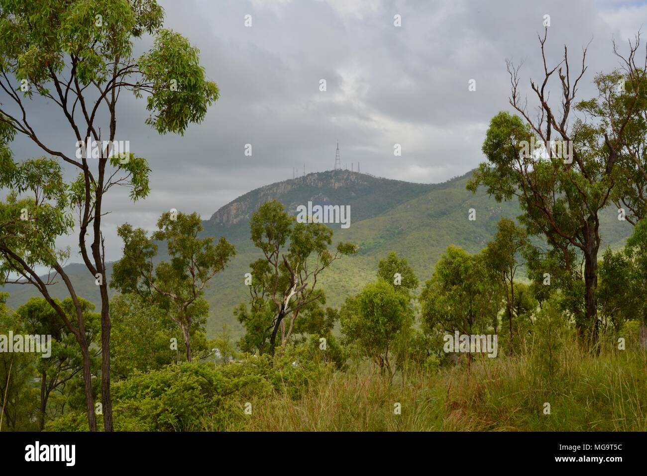 Mount stuart on a stormy day with gray clouds, Mount Stuart hiking trails, Townsville, Queensland, Australia Stock Photo