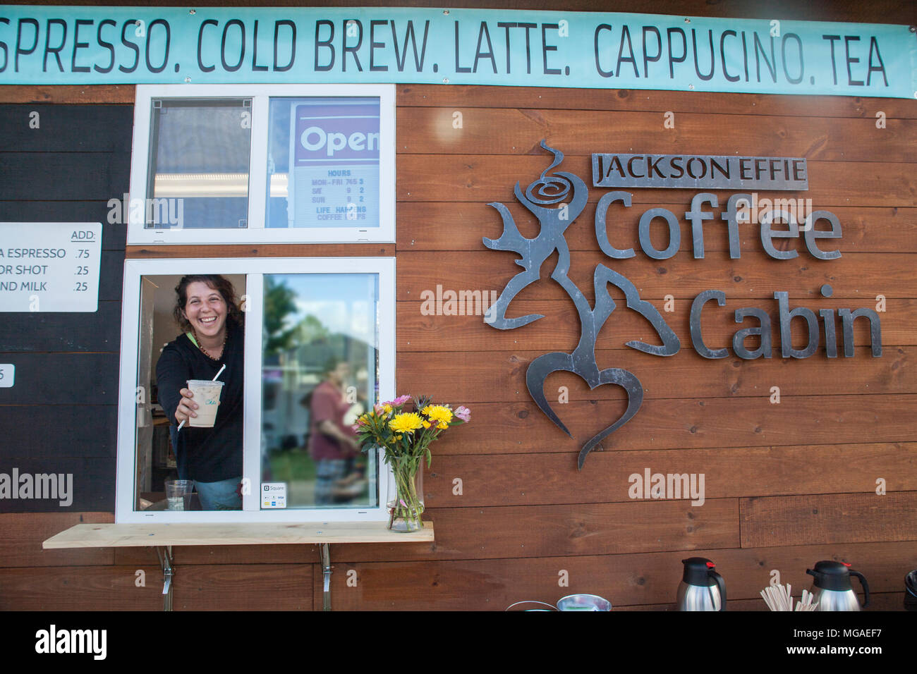 Portrait of a female owner of coffee vending food truck small businessat a food festival - Stock Image