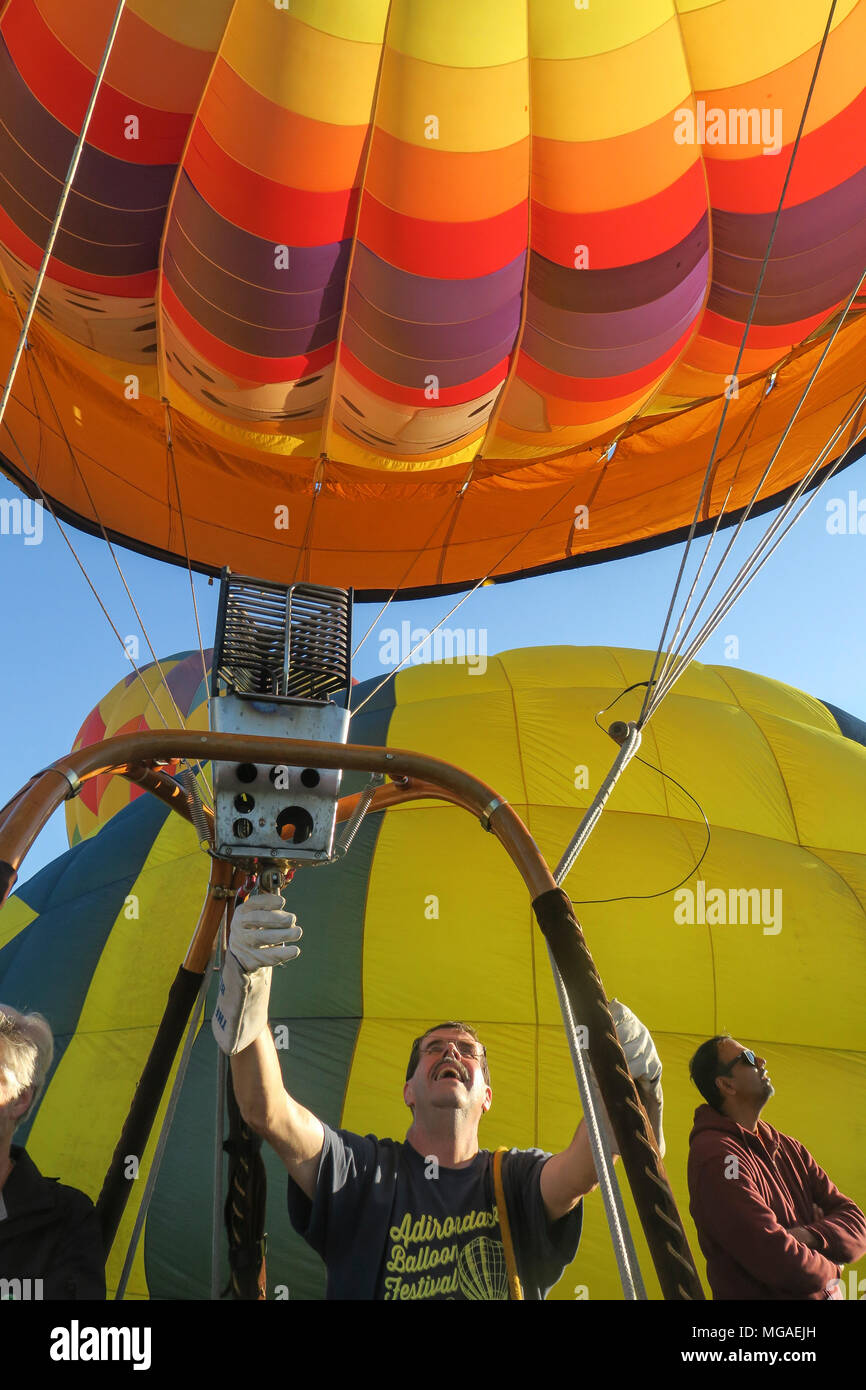 excited balloon pilot getting ready to launch his inflated hot air balloon at a Connecticut balloon festival - Stock Image