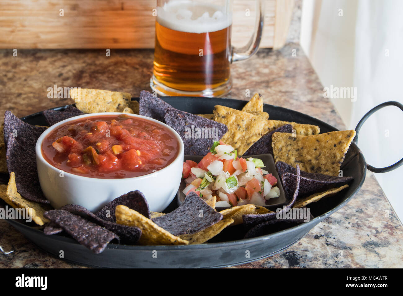 Platter Of Chips And Salsa With Beer Stock Photo Alamy