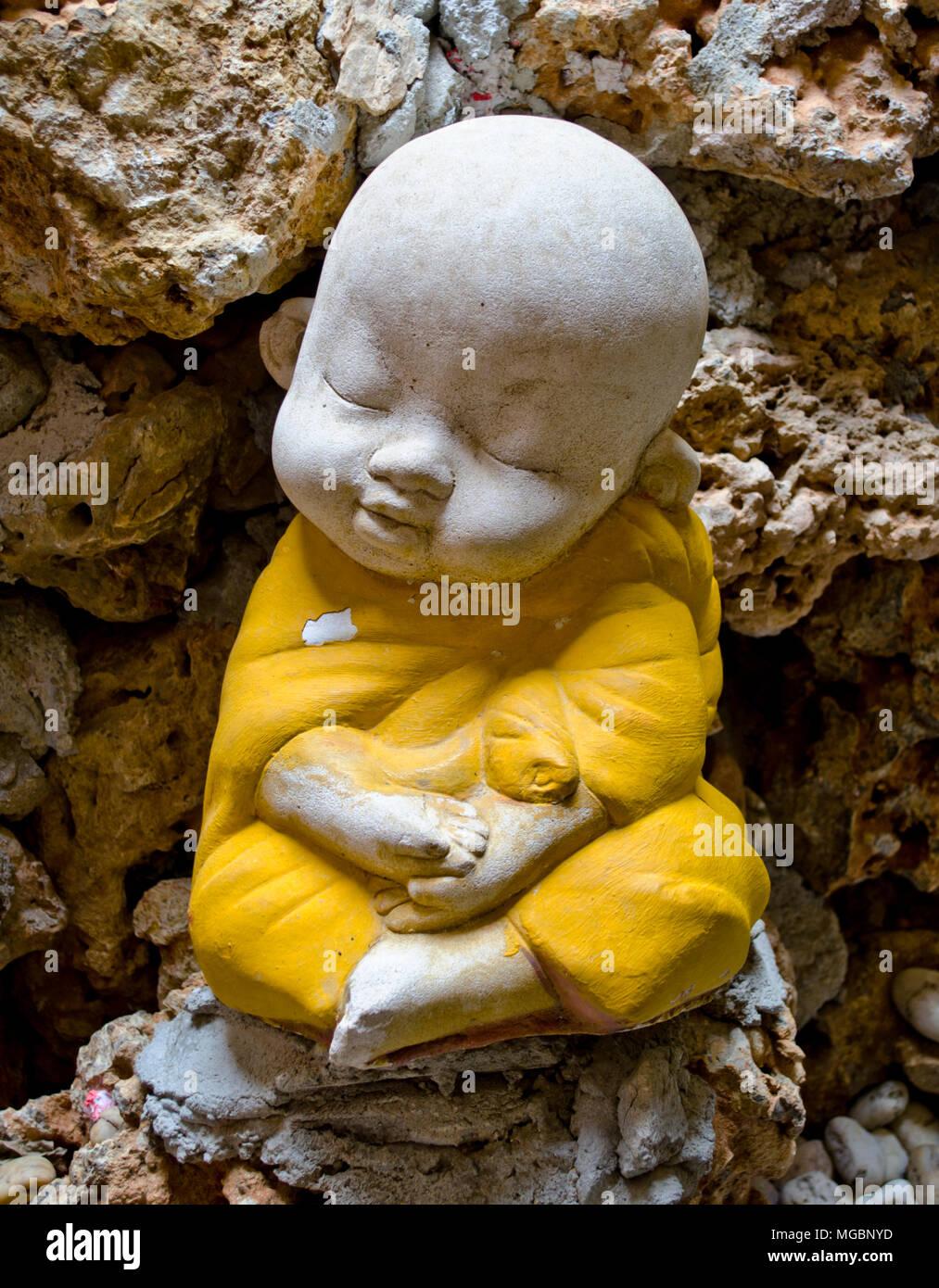 Earthenware of child monk - Stock Image