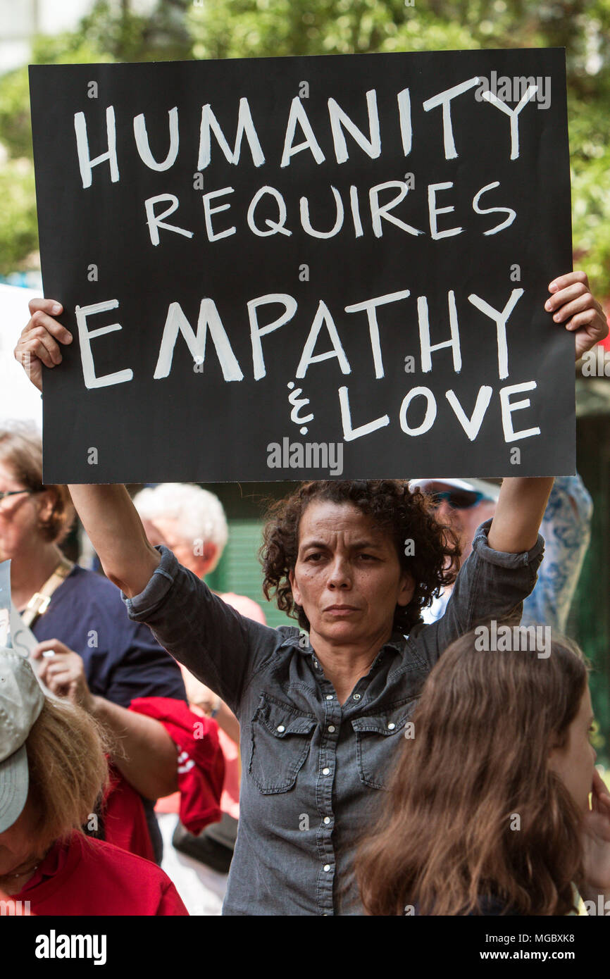 A woman holds a sign saying 'Humanity requires empathy and love' at a Moms Demand Action anti-gun rally on April 29, 2017 in Atlanta, GA. - Stock Image