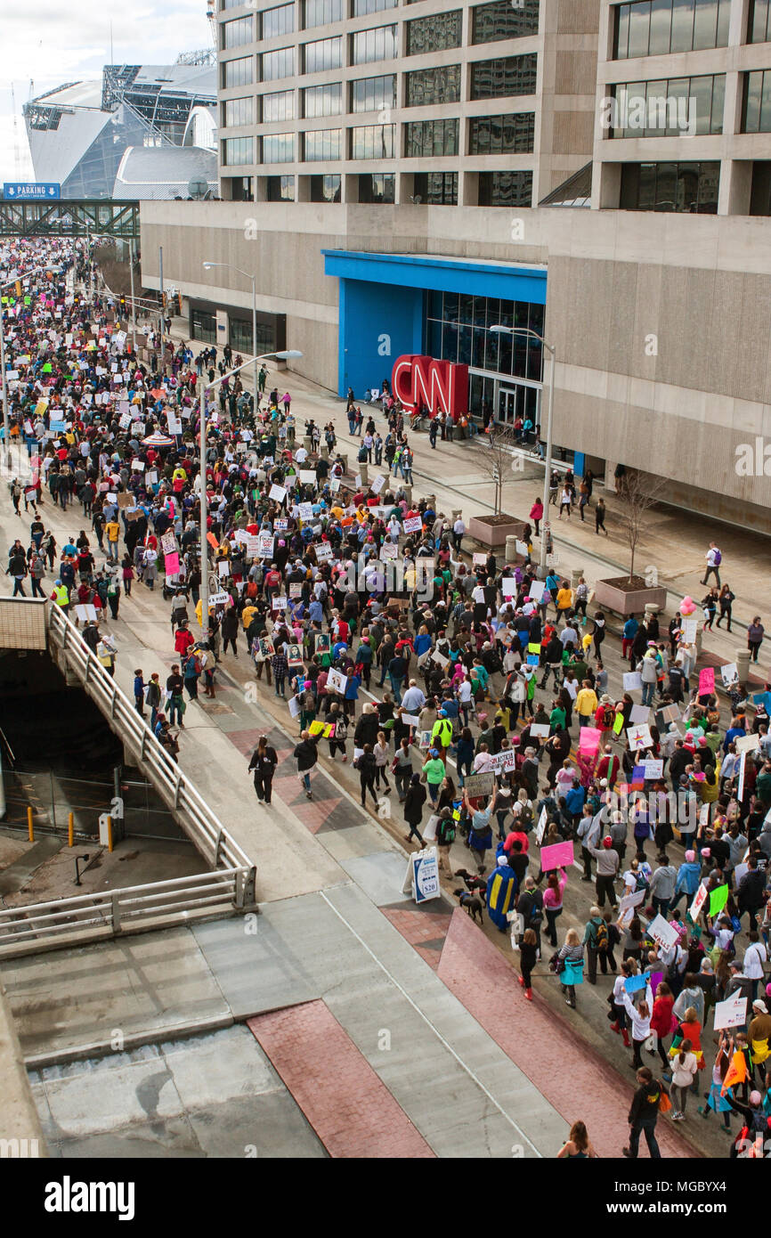 Thousands of protesters pass by CNN headquarters as they participate in the March For Women on January 21, 2016 in Atlanta, GA. - Stock Image