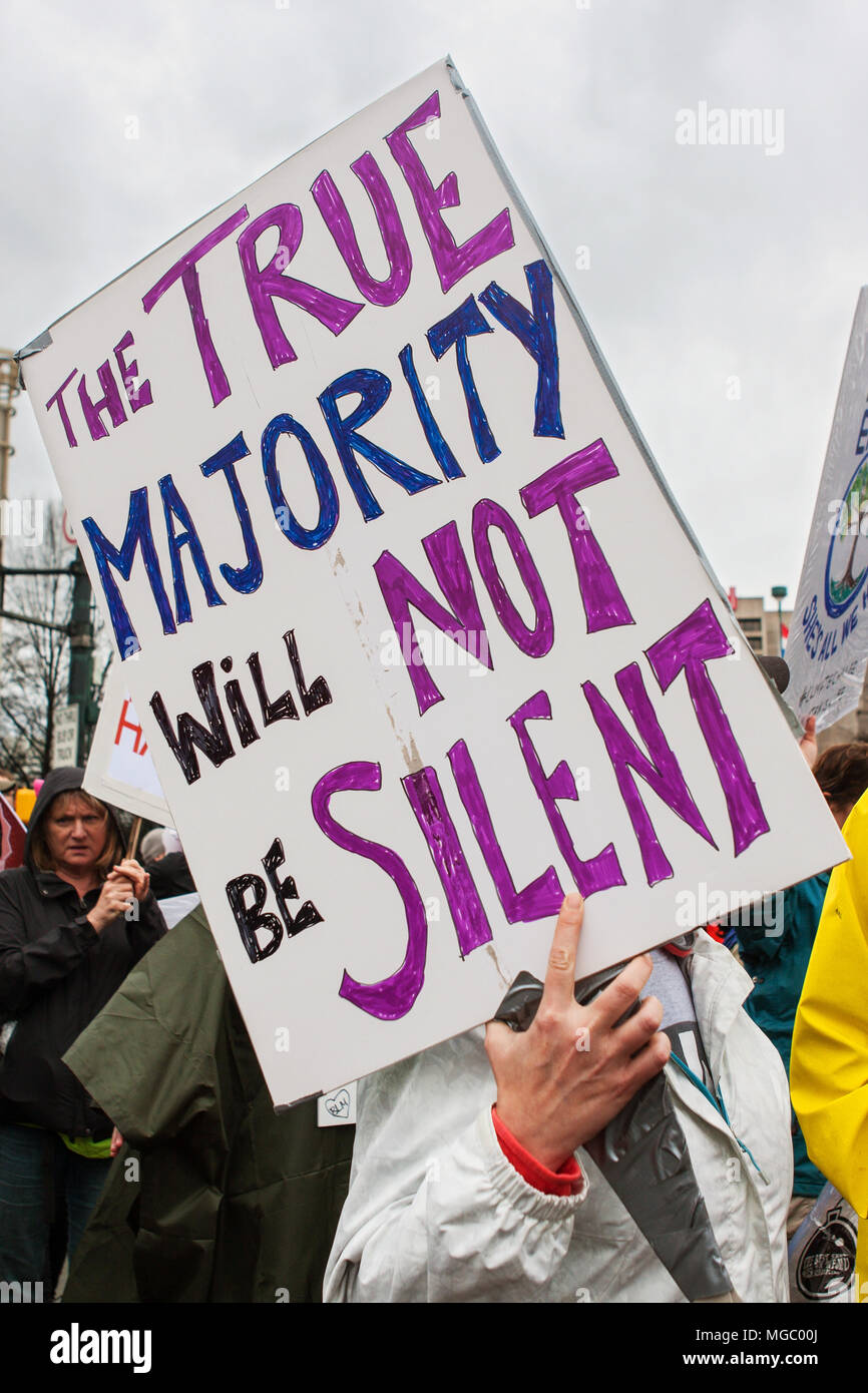A woman carries large sign that says 'The true majority will not be silent' at the March For Women on January 21, 2016 in Atlanta, GA. - Stock Image