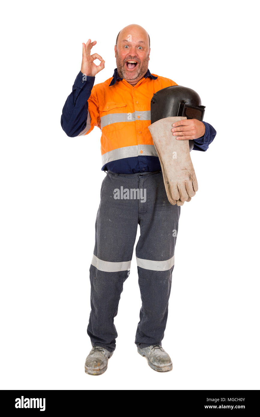 A happy and proud worker giving a positive gesture to the camera, isolated on white. - Stock Image