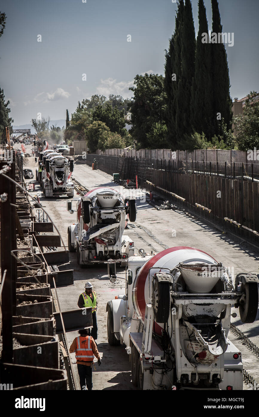 Concrete trucks waiting in line in the Hostetter Trench of the BART to Silicon Valley Berryessa Extension project in San Jose, California - Stock Image