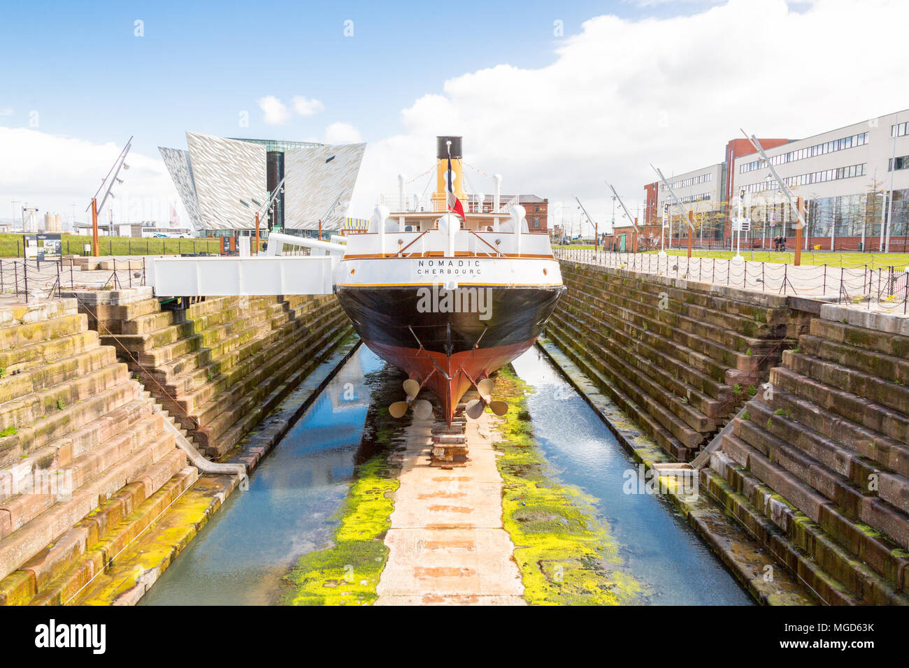Belfast/N. Ireland - May 31, 2015: In dry dock, being worked on is The Nomadic, based in Cherbourg, France. Here on a sunny day in Belfast. - Stock Image