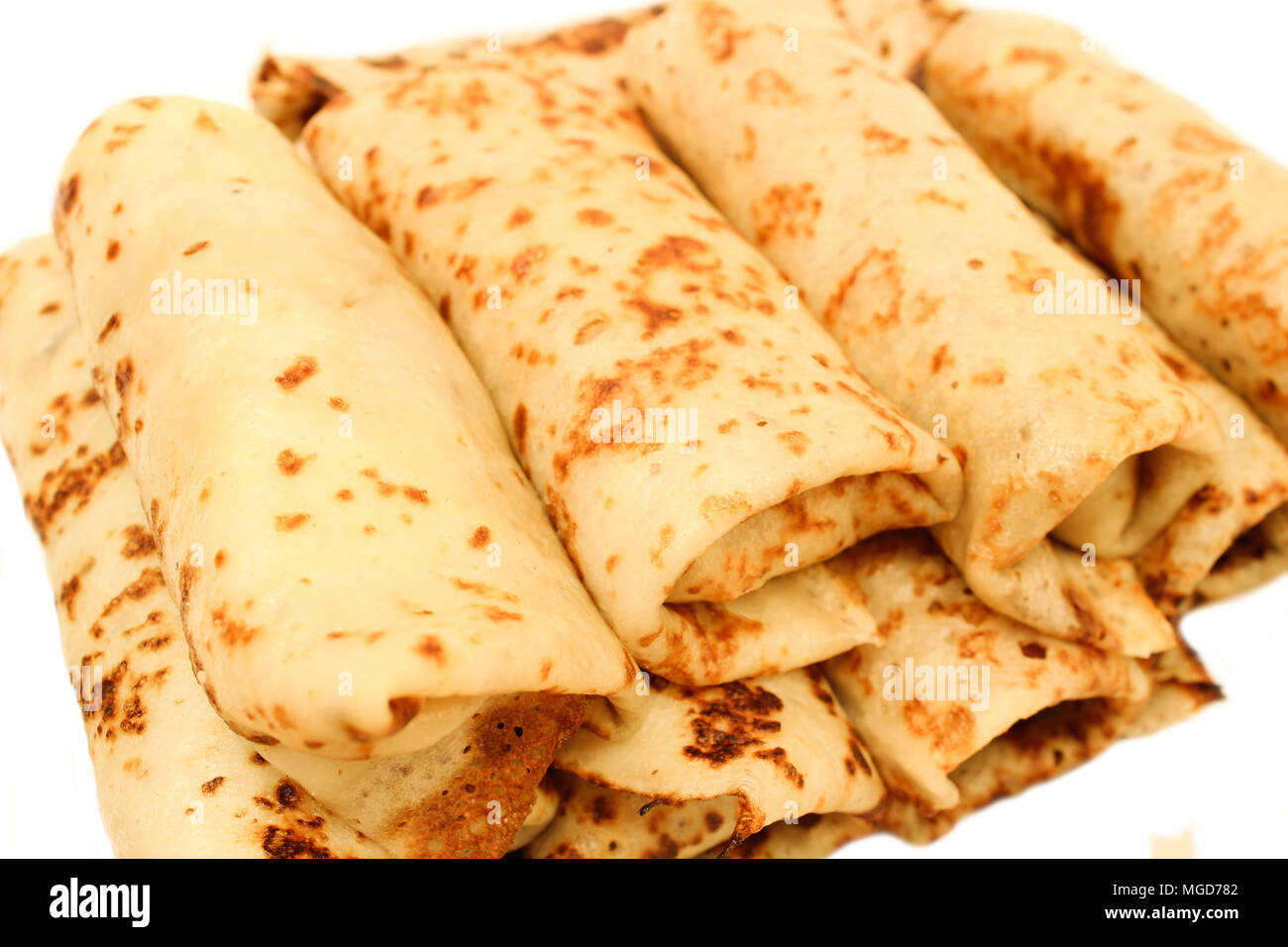 Russian pancakes with fillings wrapped in them isolated on white background - Stock Image