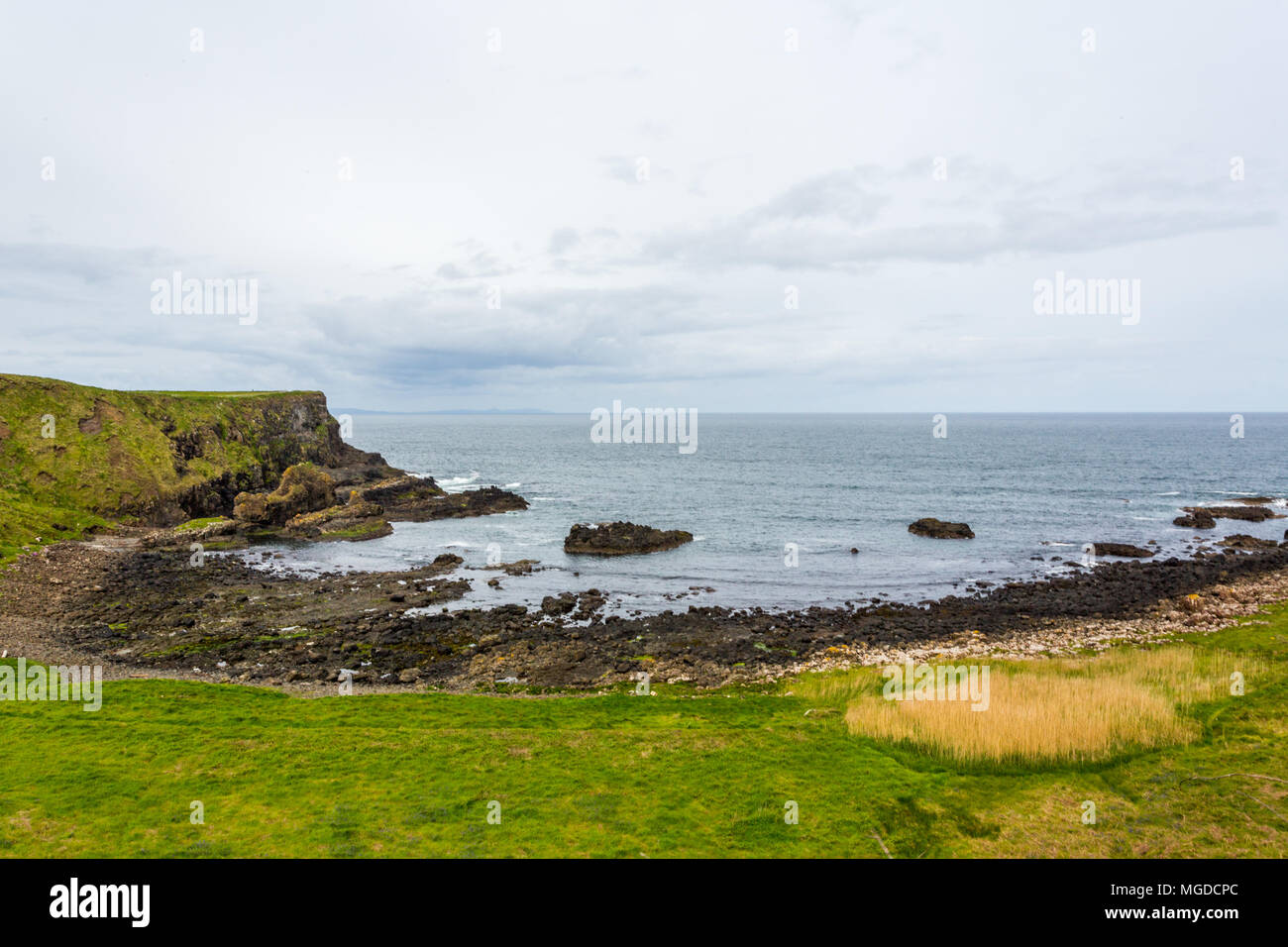 Antrim/N. Ireland - May 30, 2015: Giant's Causeway, a natural wonder produced by volcanic, hexagonal basalt rock flowing into the ocean on the Antrim. - Stock Image
