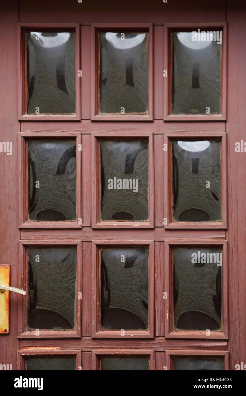 Nine Rectangular Glass at Wooden Door - Stock Image