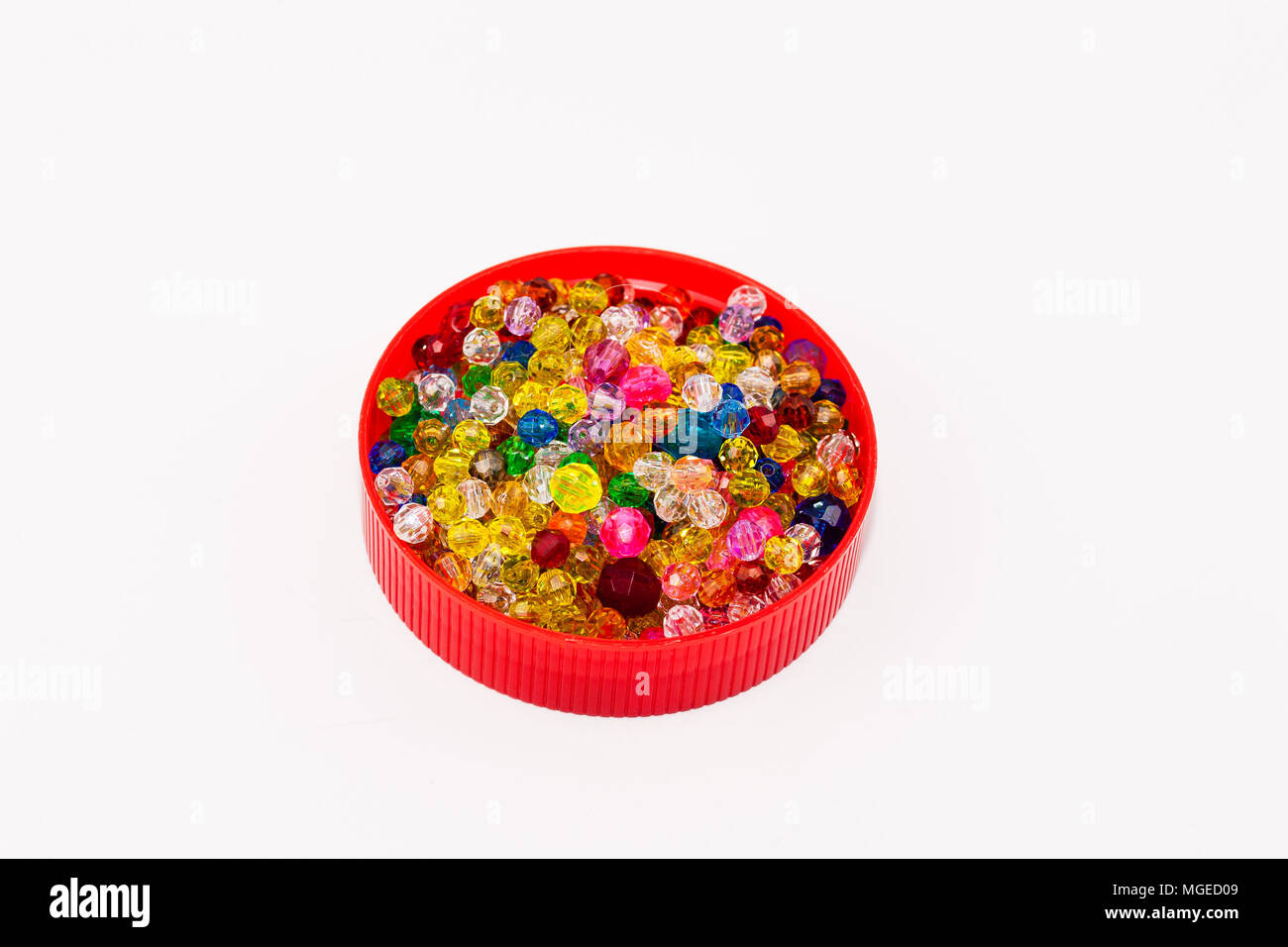 Cap full of multi colored beads - Stock Image