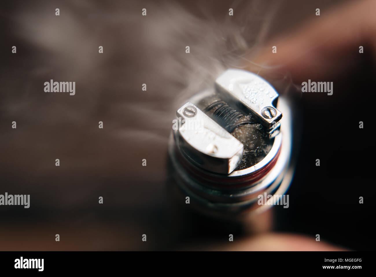 close up of a vape (e-cigarette) with vapor - Stock Image