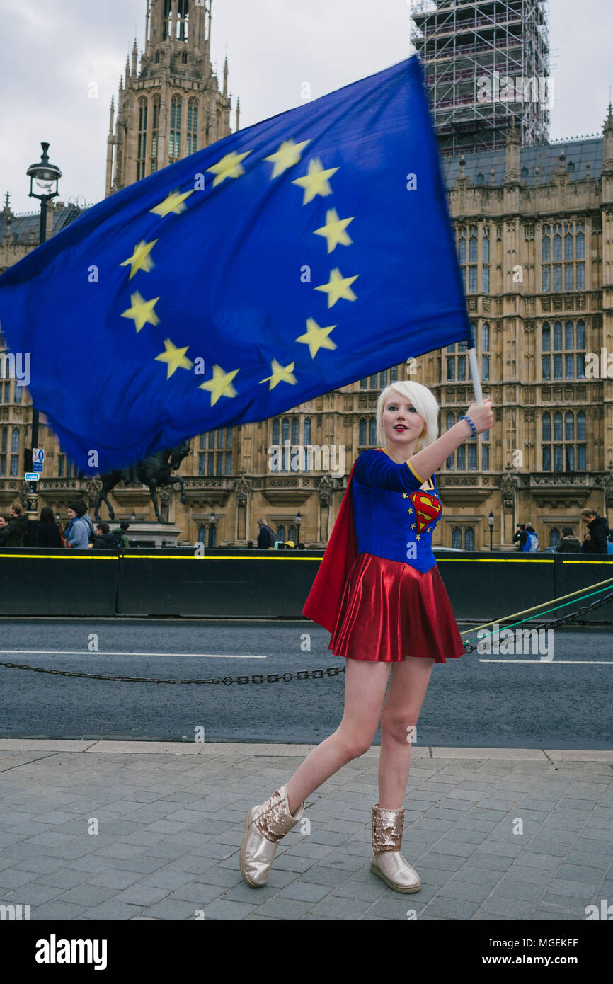 London, UK. 27th April, 2018. Madeleiena Kay, also known as EUsupergirl, waving an EU flag outside Westminster, in support of Remain campaign against  - Stock Image