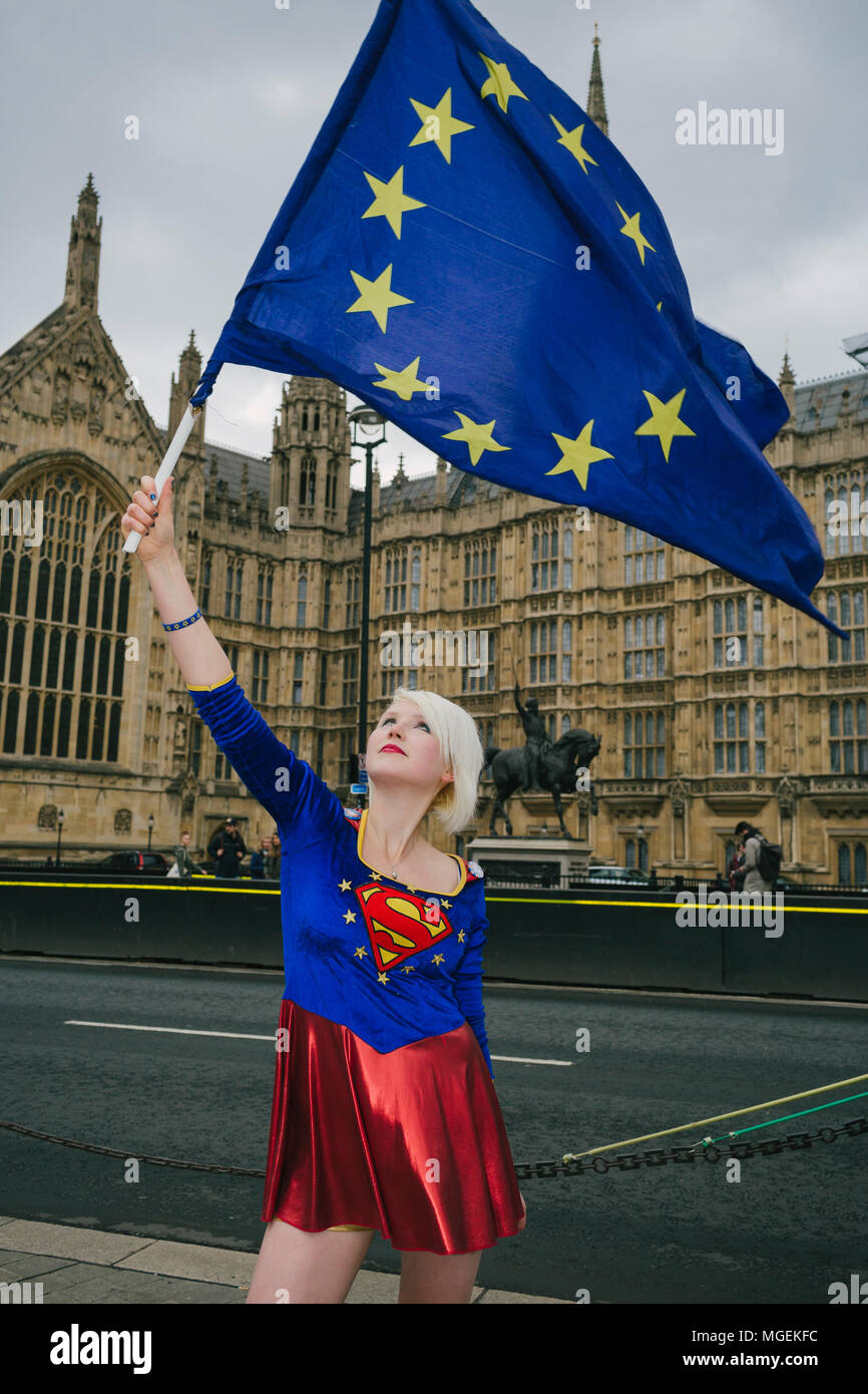 London, UK. 27th April, 2018. Madeleina Kay, also known as EUsupergirl, waving an EU flag outside Westminster, in support of campaign against Brexit - Stock Image