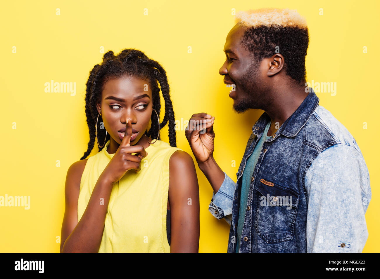 Stop lying to me. Angry beautiful Afro-American girl feeling mad at her unfaithful husband, ignoring his excuses, not believing in lies. - Stock Image