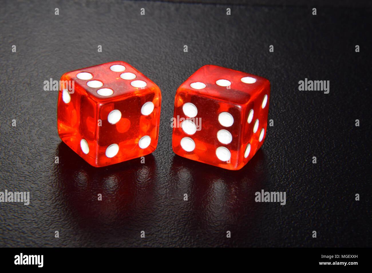 Red luminescent casino gambling dice on black background Stock Photo